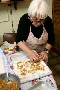 Mum rolling filo for baklava
